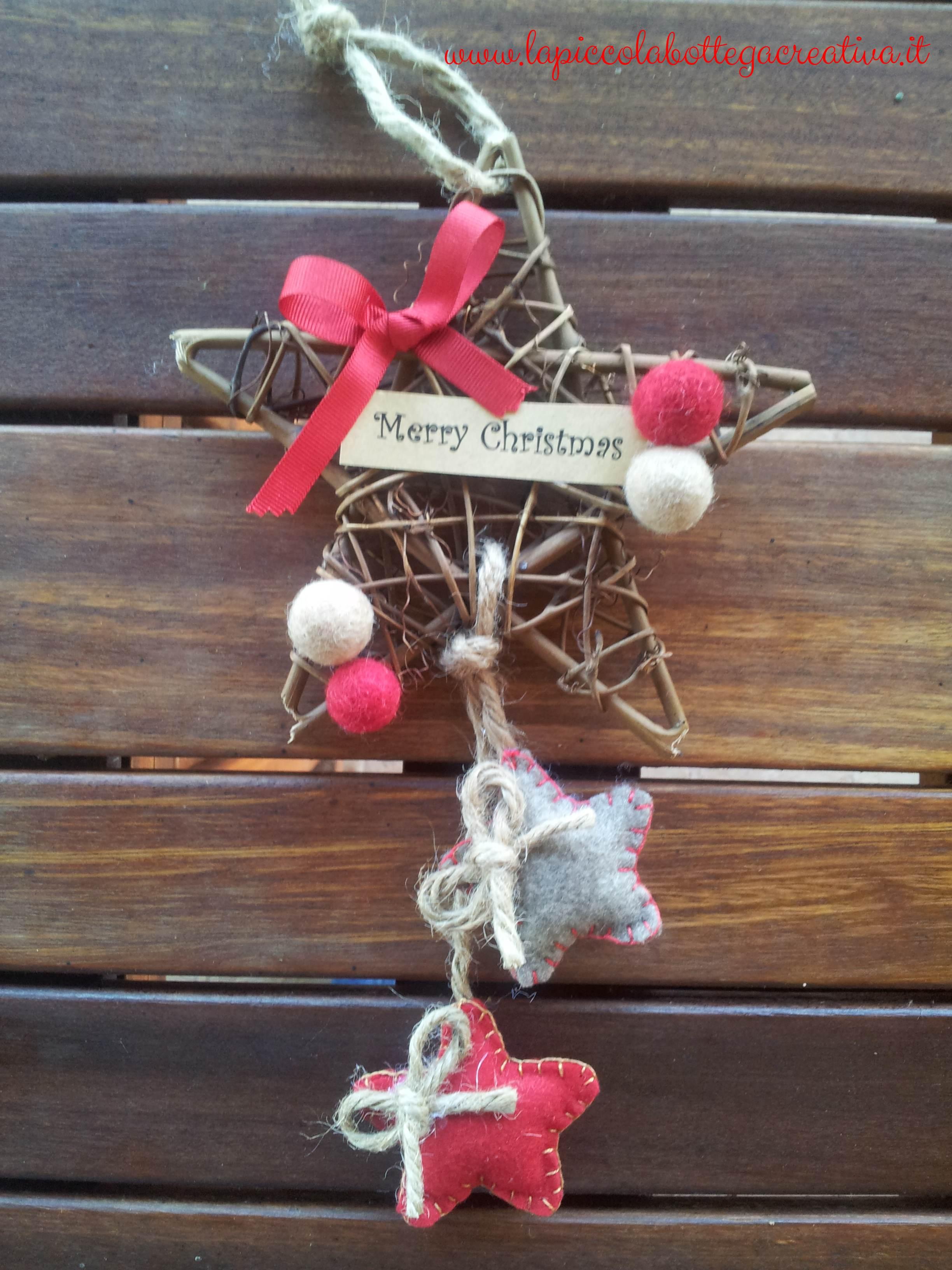 Stella legno natalizia decorata in feltro
